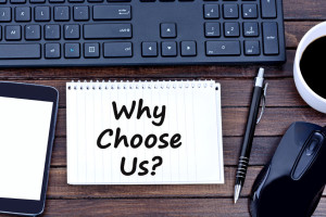 69771774 - question why choose us on notebook closeup